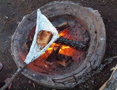 making grilled ham and cheese while camping using a stick and aluminum foil. Great for camping or bonfires in the fire pit by our mountain cabin! Diy Camping, Bushcraft Camping, Camping Glamping, Winter Camping, Camping Meals, Camping Hacks, Camping Recipes, Family Camping, Backpacking Meals