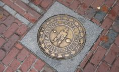 Freedom Trail, red brick path through downtown Boston, Massachusetts that leads to 17 historical sites.