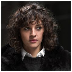 How to wear curly bangs with style & class. . .