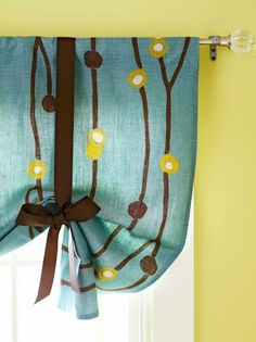 Gather your curtains at whatever height you want with the addition of a ribbon in a pretty accent color. More curtain makeovers: http://www.midwestliving.com/homes/decorating-ideas/15-diy-curtain-makeovers/page/4/0