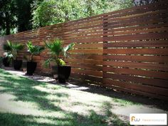 Horizontal board fence design. This fence was made from ironwood. One of the hardest wood species available. This modern style has a great look. #modern #fencing