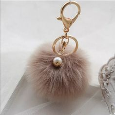 Puff ball keychain Glam up any bag with this faux fur puff ball keychain in the color brown Accessories Key & Card Holders