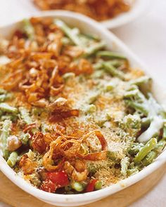The classic green-bean casserole gets a makeover with fresh green beans and homemade mushroom sauce. A layer of breadcrumbs, Parmesan cheese, and fried shallots form a wonderfully crisp and savory topping.Get the Green Bean Casserole Recipe Greenbean Casserole Recipe, Casserole Recipes, Vegetarian Casserole, Casserole Ideas, Tuna Casserole, Vegetarian Meals, Thanksgiving Side Dishes, Thanksgiving Recipes, Christmas Recipes