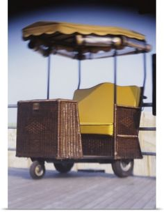 Poster Print Wall Art Print entitled Rolling chair on a boardwalk, Atlantic City, New Jersey, None
