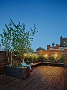 The warm hues of Ipe wood and lush garden planters create an intimate outdoor setting at dusk in this urban deck design. Rooftop Garden Magnificent Deck Designs for Every Taste Roof Terrace Design, Rooftop Design, Deck Design, Window Design, Terrasse Design, Balkon Design, Rooftop Terrace, Terrace Garden, Terrace Ideas