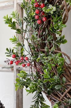 Learn how to create a boxwood and berry wreath for Christmas plus tips for a creative way to display it.