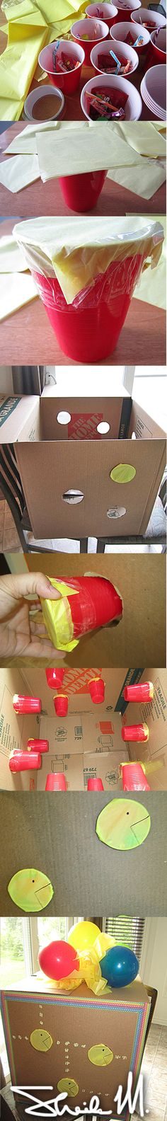 How to make a PUNCH surprise box for kids party. Awesome alternative for a piñata. Perfect for indoor or with no hanging options. Did a Pacman theme. Kids LOVED it!!! Use only 2 thin layers of gift paper and use a bigger cup to put the candy. Use the cup for template but cut it a bit smaller so it holds better in the hole. Took me about 2 hours. It was the talk of the party! Enjoy!!!