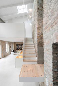Hamburg studio Asdfg Architekten has converted a 19th-century miller's house in…