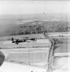 Film still showing Avro Lancaster B Mark Is of No. 5 Group, flying at low-level over the French countryside on the evening of 17 October 1942, while en route to attack the Schneider engineering factory at Le Creusot, France. The nearest aircraft, R5497 'OF-Z', of No. 97 Squadron RAF, is being flown by Flying Officer J R Brunt and crew, who were shot down and killed on an operation in the same aircraft exactly two months later.