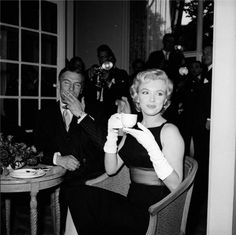 Marilyn Monroe drinking tea with Laurence Olivier at the Savoy Hotel London, 1956.