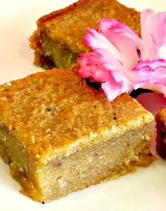 This Trinidad and Tobago cassava pone is pretty amazing! Made with (Goya Frozen Cassava and Coconut) so moist and delicious, you won't believe they were made with frozen ingredients. Trinidadian Recipes, Guyanese Recipes, Jamaican Recipes, Guyanese Bake Recipe, Yuca Recipes, Dhal Recipe, Cake Recipes, Dessert Recipes, Pudding