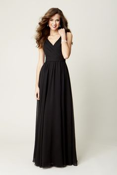 A long, chiffon bridesmaid dress with a flattering strapped neckline.