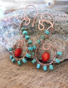 Swirl.  Turquoise Dyed Howlite, Coral, and Hand Forged Hammered Copper Swirl Dangle Earrings