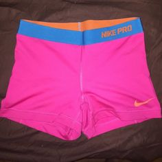 8fad2d884 Nike Compression Shorts Hot pink with blue waist band and orange swoosh.  Only worn a few times Nike Shorts