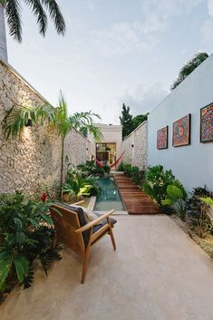 Located in Merida's historic downtown district, this 1560-square-foot house is an oasis in the city. Indoor/outdoor living serves as the foundation of the project's design, and regional materials and textures provide a sense of identity. #dwell #plants #indoorplants #outdoorplants #garden #gardening