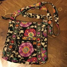 Vera Bradley cross body bag Vera Bradley cross body bag.. Used but in good condition. Captured the only wear I see in the 3rd picture. No stains. 11 inches x 10.5 inches Vera Bradley Bags Crossbody Bags