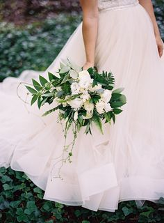 Megan's white and green bouquet was filled with garden roses, fern and a lush green foliage.  Floral Design byLisa Foster Floral Design. Pic by Clark Brewer