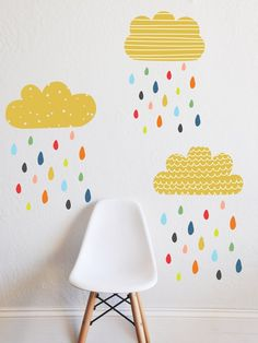 Fun and whimsical wall decals are a quick way to create a gorgeous kids room on the budget - These fun patterns and pops of color will inspire creativity and fun - COLORFUL RAIN
