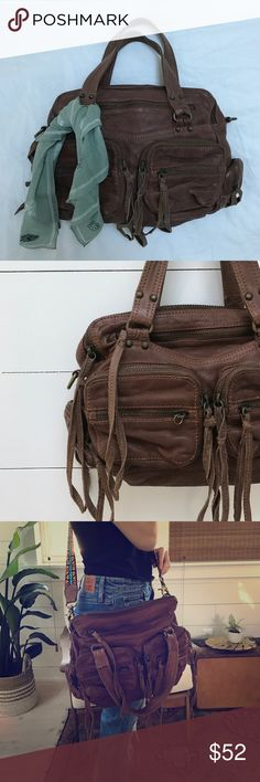"""Free People Leather Shoulder Handbag Tote Genuine leather handbag from FP. Measures 15"""" long 10"""" high, including  side pockets. The handle has an 8"""" drop. Bag has a dualzipper system for the main compartment so its great for a small Macbook/iPad/Books with personal items on the other side. Would make a cool diaper bag too. Has 10 zipper pockets. This is used but no real signs of wear stick out to me - see back - there are no dreaded denim stains! Comes w/ rainbow removable strap thats super…"""