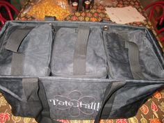 See how nice they fit?  And think one or 2 were thermal, you are ready for every tail gate party, snack mom event, picnic, anything!!  The top a tote keeps it covered for those rainy days!