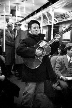 Woody Guthrie busking on a NYC subway