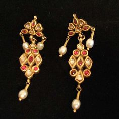 India   Earrings; 22ct gold, white sapphires, rubies, pearls.