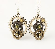 """Made in U.S.A Style # 5003B Size 1.65"""" x 1.5"""" Kinetic Gear Earring 5003B All Gears Move! Comes as shown -Natural Wood/Tan/Brown/Apple Green Made from sustainably sourced materials Laser-cut wood Stained with water based dye Ear wires are silver-finished 3041 stainless steel with new electrophoretic-coating that resists tarnishing"""
