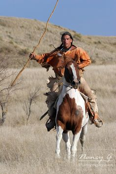 A Native American Lakota Sioux riding horseback on the prairie of South Dakota | Nancy Greifenhagen