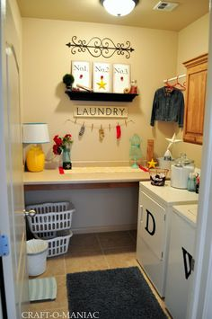 Such a fun laundry room! By Craft-O-Maniac   I have front loaders so the letters wouldn't work but love the concept