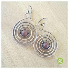 Wire spiral earrings made of copper. These big copper hoops are hand shaped and hammered for more strenght, antiqued and polished by hand. I adorned these earrings with brown jasper beads. All my copper jewelry are treated with a special wax to protect the copper and for long