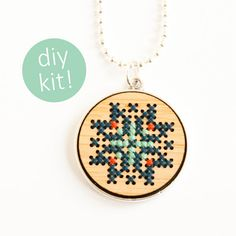 Items similar to Cross Stitch Jewelry Kit // Hand Stitched Wood Pendant in Silver Frame // DIY Kit on Etsy Mini Cross Stitch, Modern Cross Stitch, Cross Stitch Kits, Cross Stitch Patterns, Cross Stitching, Cross Stitch Embroidery, Embroidery Patterns, Print And Cut Silhouette, Jewelry Kits