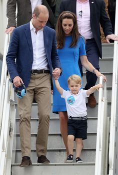 Catherine, Duchess of Cambridge, Prince William, Duke of Cambridge and Prince George during a visit to the Royal International Air Tattoo at RAF Fairford on July 8, 2016 in Fairford, England.