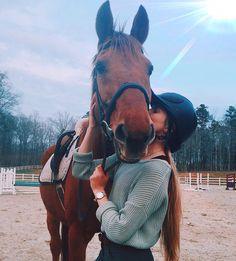 Horse kiss in the sunshine. Good boy!