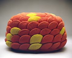 """""""artichoke"""" - A flower shaped pouf made of a 156 crocheted orange and yellow polyester shapes - project by monomoka"""