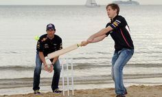 Sebastian Vettel, right, plays cricket with his F1 team-mate Mark Webber at a beach barbecue put on by Red Bull in Melbourne. Photograph: William West/AFP/Getty