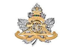 The Queen has received a new Canada brooch to mark her 60 years on the throne. it is diamond, gold, and platinum and and was designed by Birks (Canada's answer to Tiffany's). It was commissioned by the Royal Regiment of Canadian Artillery, who presented it to the Queen at Buckingham Palace in January 2012.