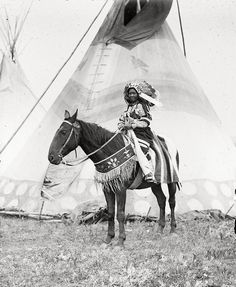 A Blackfoot/Siksika girl. Name unknown, 1909. Photo by Walter McClintock.