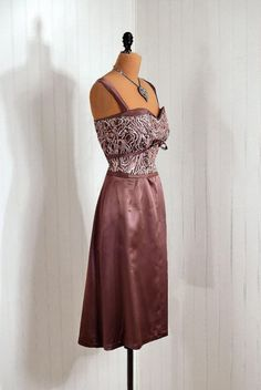 """Couture Cocktail Dress, Affa Colombo, Milano: 1950's, iridescent heavily-sequined lined satin, sweetheart shelf-bust bow bodice, back slight fishtail """"wiggle"""" skirt."""