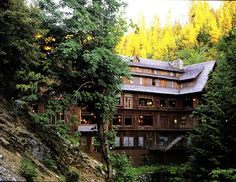 #Oregon #Caves #Grants #Pass   Chateau at the Oregon Caves. Towering high among the old growth in the Siskiyou National Forest is this six-story historic grand lodge. Nestled in a gorge against an embankment (enter from the parking lot on the fourth floor) and overlooking a trout grotto, the chateau is open from May 8 to September 29. Ease your way into wilderness an hour-and-a-half from Grants Pass with a leisurely drive up the winding access road.
