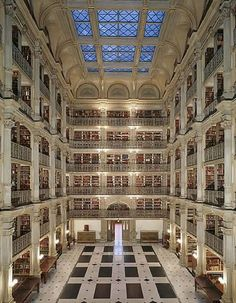 The George Peabody Library at Johns Hopkins University in Baltimore, Maryland. Completed in the library was designed by Baltimore architect Edmund G. Lind ato be a cathedral of books. Beautiful Library, Dream Library, Library Books, Grand Library, Library Bedroom, World's Most Beautiful, Beautiful Places, Absolutely Stunning, Peabody Library