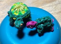 """Two TURTLES loomed by Gail J. Murphy on the Rainbow Loom. Gail said: """"Smaller one - PG Loomacy tutorial. Larger one inspired by Dawn Singleton design using Kaleidescope pattern (craftfantasy tutorial) but double banded. Head is done similar to small turtle, but 3 prong instead of 2, gives the wider head."""" (Rainbow Loom FB page)"""