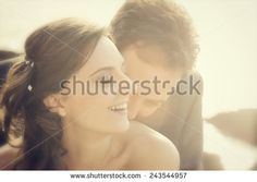 Portrait of married couple in day of their wedding.