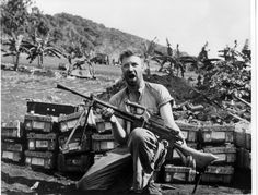 US Marine on Saipan with a captured Japanese light machine gun, and what looks to be large supply of ammo.
