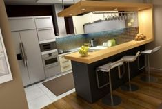 Результатом сотрудничества британской фирмы Smallbone of Devizes и. известного дизайнера Келли Хоппен стала оригинальная современная кухня с барной стойкой