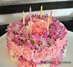 """Warning: This treat isn't edible — but it is really fun to look at, right? The next time you're invited to a party that requests no presents, bring this stunner. Two blocks of foam cut into a circle act as the base, and cheerful flowers are the """"icing"""" on top. Get the tutorial at Celebrate & Decorate » - HouseBeautiful.com"""