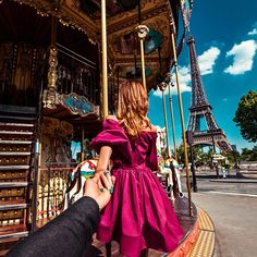 Follow me to the Eiffel Tower in Paris. Murad Osmann @muradosmann - we have been on that carousel