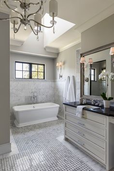 This elegant grey French bathroom features custom vanity. Vanity with soapstone countertop and marble basketweave floor tiles. Hendel Homes Bathroom Renos, Grey Bathrooms, Bathroom Flooring, Beautiful Bathrooms, Bathroom Windows, French Bathroom, Master Bathroom, Stand Alone Tub, Master Bath Remodel