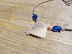 Broken Seashell Necklace with Swarovski Crystal Fish Beads - Seashell Jewelry / Nautical / Beach  This piece of seashell was collected by me on