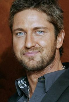 Gerard Butler   yep I think Id like to eat him !  ops did I say that out loud..ha ha