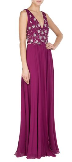 In a rich shade of magenta, Jenny Packham's silk chiffon dress is striking in its dazzling finish. Crystal and bead embellishment add fanciful flair, with a V-neckline to show just enough skin #Stylebop